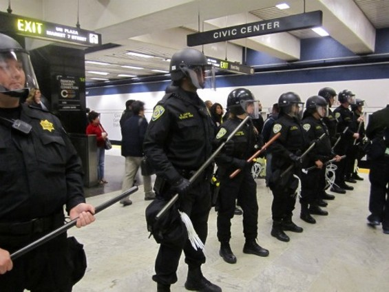 Riot police at Civic Center BART station