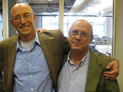Robert Kenner (right) with author Michael Pollan. - WNYC/FLICKR