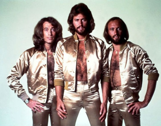 Robin Gibb, left, with his brothers in the Bee Gees.