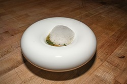 ALEX LEBER - Saison's modern plating, as seen in the wild rice stew with abalone liver and coastal sea greens.