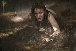 LACEY TERRELL - Sara Paxton crawls away from the sadistic baddies and toward safety.