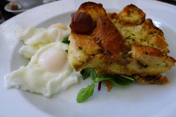 Savory bread pudding with poached eggs and mixed greens - QUINOA HASH WITH TWO EGGS, CARROTS, SPINACH AND NUTRITIONAL YEAST