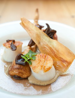 MELISSA BARNES - Seared scallops and a number of intriguing flourishes.