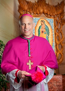 SF Archbishop Salvatore Cordileone, seen here in a lovely pink top, doesn't think gays should marry.