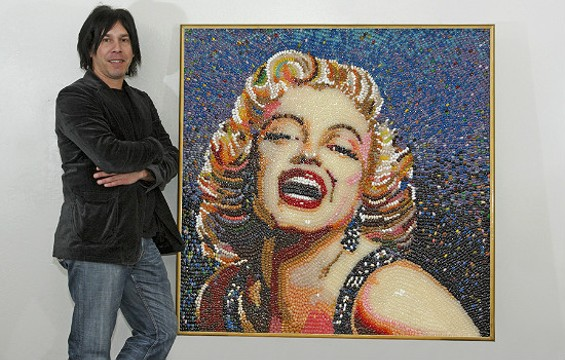 S.F. Artist Roger Rocha poses with his jelly bean portrait of Marilyn Monroe. - ANNA ROTH