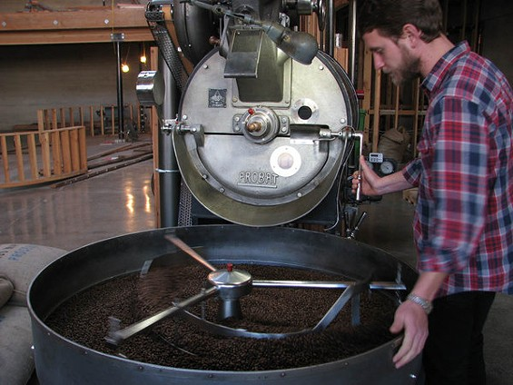 Sightglass roaster CC at the German-made Probat. - CATHERINE COLE