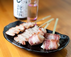 ALBERT LAW - Skewers at Halu: pork jowl, left, and bacon-wrapped mochi.