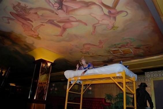 Skramstad checks out her own handiwork that sprawls across the ceiling