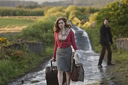 Smart, stylish Amy Adams has to get muddied and ridiculed in order to get her man (Matthew Goode).