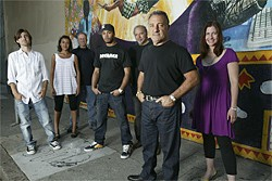 IAN VAN DOMMELEN - SMC Recordings, from left to right: Will Bronson (co-founder), Maureen Akika (accounting/office manager), Chris Hollis (VP sales), George Robertson (VP marketing), George Nauful (co-founder), Ralph Tashjian (co-founder), Kate Wolfson (national promotions director).
