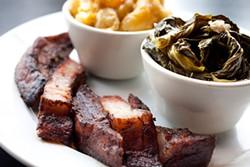 LARA HATA - Sneaky's pork belly is coal-black on the outside.