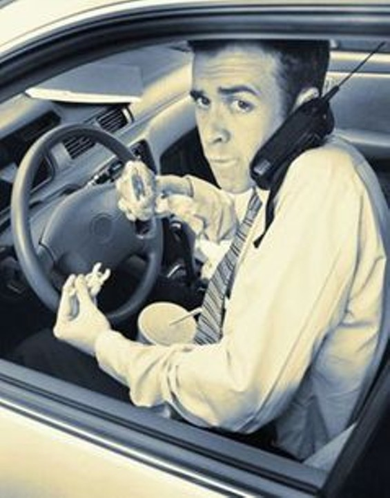 driving_on_cell_phone_and_eating_thumb_240x305.jpg
