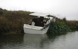 Some inconsiderate bastard left this boat to rot in the San Joaquin Delta - COURTESY OF THE DEPARTMENT OF BOATING AND WATERWAYS