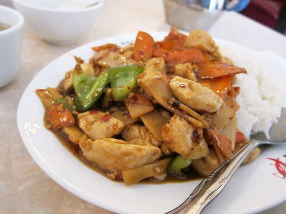Spicy chicken over rice ($6), a daily lunch special. - LUIS CHONG