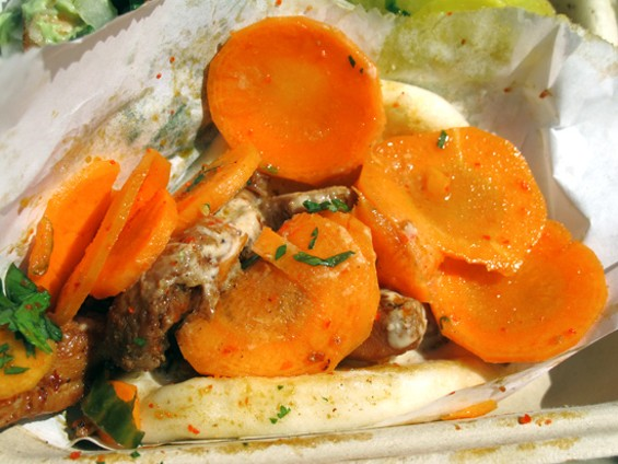 Spicy chicken steamed bao with sweet-tart pickled carrots - LOU BUSTAMANTE