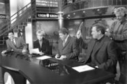 PAOLO  VESCIA - Sports anchor Gary Radnich (right) preps for air during a commercial break.