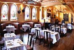 JAMES  SANDERS - Stained-glass windows shed a benevolent - light on O'Reilly's dining room.