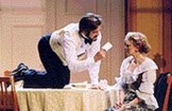 KEN  FRIEDMAN - Stephen Caffrey's Torvald shows Ren - Augesen's Nora how to set a table.