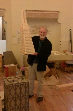 Steve Fox holding an unfinished model of the mini-golf version of the Transamerica Pyramid. - JUAN DE ANDA/SF WEEKLY
