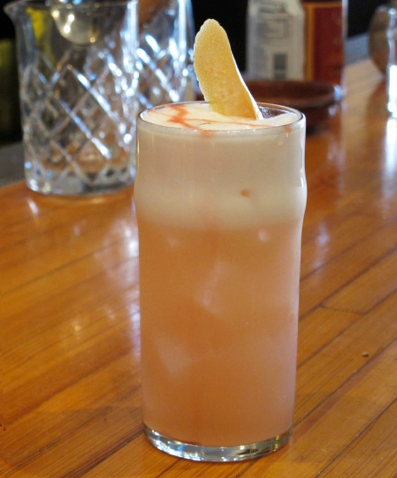 Sunset in Seville (bitter orange liqueur, prosecco, lemon, egg white) cocktail - LOU BUSTAMANTE