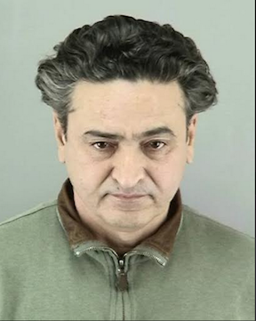 Suspect Syed Muzzafar, who allegedly hit a family in the crosswalk at Polk and Ellis Streets on New Year's Eve. - SFPD BOOKING PHOTO