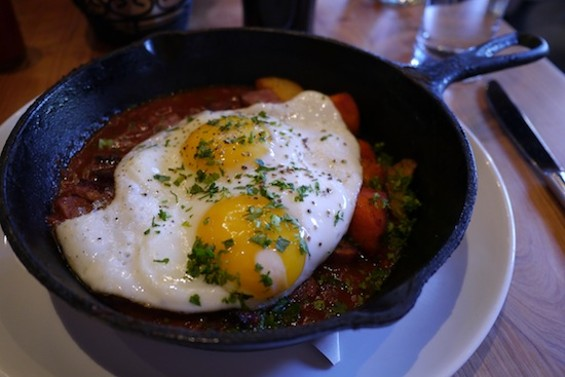 Sweet Potato & Andouille Hash, with baked eggs and sauce piquant