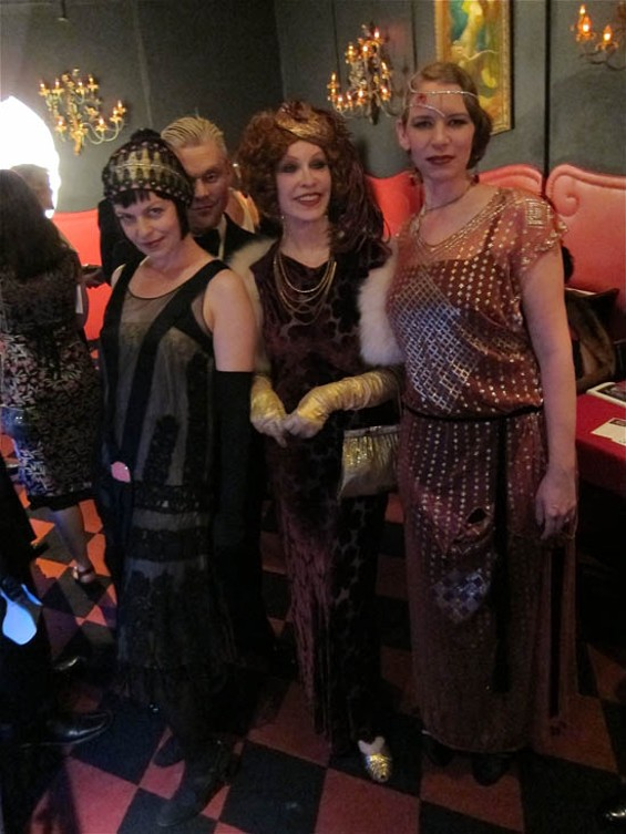"""HEADDRESSES BY """"MATA HARI'S DAUGHTER"""" CARLY REYNOLDS (RIGHT)."""