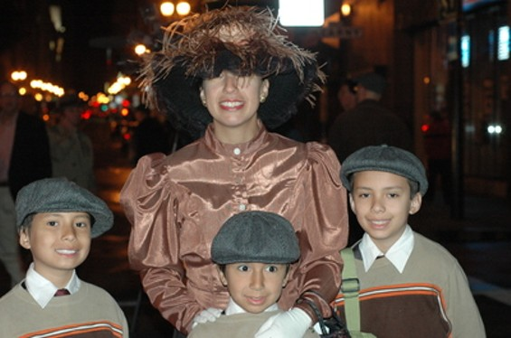That would be Azalia Merrell along with her boys (from left) Phineas, David, and John. But wait -- there's more.