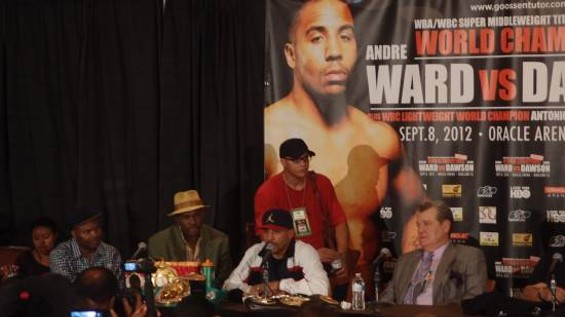That's Hunter in the red shirt and black hat after star pupil Andre Ward's big win last month. - ALBERT SAMAHA