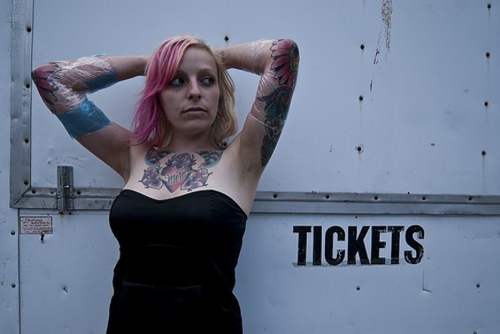 That's the ticket: Angelica Olmos, 20, shows off the bodywork she got at the weekend's Tattoo Expo - ALL PHOTOS   |   DANIEL C. BRITT, USED WITH PERMISSION