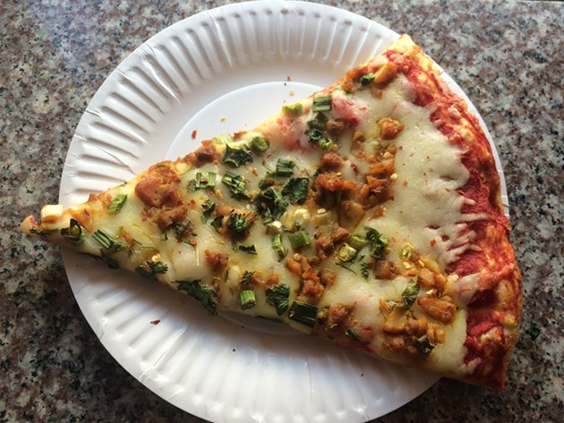 The $1.99 slice at Great Indian Food is considerably smaller. - PETE KANE