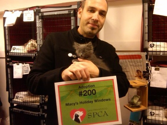The 200th Macy's window adoptee and its new owner. One is named Robert. The other is Marmoset. - SPCA