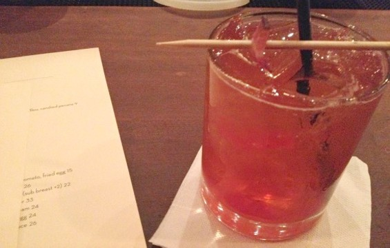 The bacon old-fashioned is garnished with a strip of bacon. - ANNA ROTH
