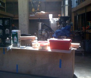 The coffee roaster and front bar, with skylight and construction crap.