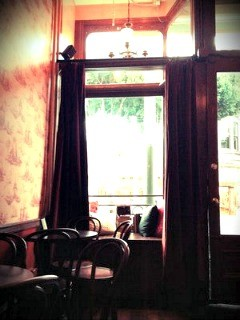 The cozy window reading nook at Two Sisters. - YELP/ERIN M.