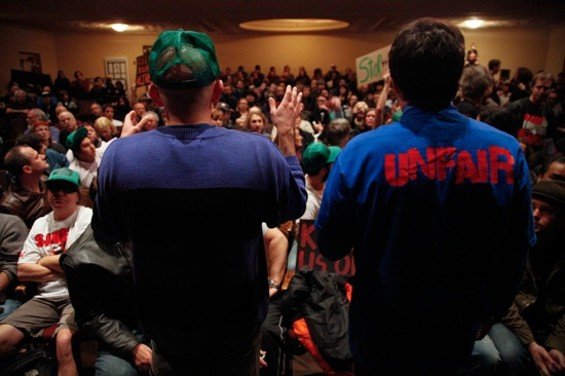 The crowd at a gathering to protest the sale of KUSF in January. - CHRIS STEVENS