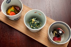 LARA HATA - The daily obanzai: Vegetables three ways come in clay cups.
