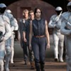 """The Hunger Games: Catching Fire"": A Girl Torn Between Two Boys and an Evil President"