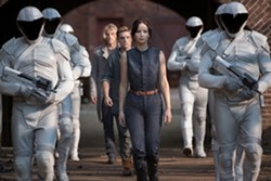 The denim jumpsuit continues to exist in the dystopian future. But Jennifer Lawrence wears it well.