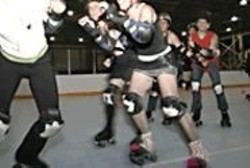 GABRIELA  HASBUN - The Derby Girls skate late at night in a converted - hangar because it's the only time they can secure a - rink to themselves.