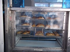 The dough is classic Chilean, the fillings skew Cal-Med. - MAMA'S EMPANADAS/FACEBOOK