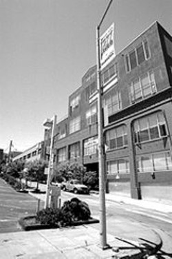 PAUL  TRAPANI - The drab view down Lansing Street.