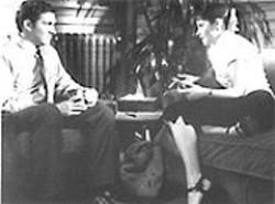 GEMMA  LAMANA - The Elmer Gantry of Psychotherapy: Loren Dean (left) analyzes Zooey Deschanel.
