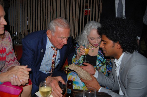 "The embodiment of random, Foursquare cofounder Naveen Selvadurai appears to ""ice"" Apollo 11 astronaut Buzz Aldrin at the Webby Awards afterparty. - RANDOM NIGHT OUT/NICK MCGLYNN"