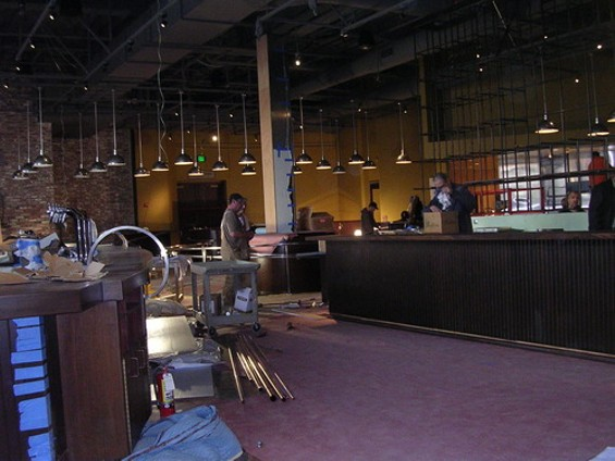 The entrance to Public House; note the metal keg wall (right) that separates bar from TV area. - J. BIRDSALL