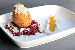 ANNA LATINO - The Faberge version of the old bar staple: A Scotch egg on a bed of beet confit with salmon roe and crème fraiche.