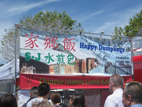 "The Happy Dumpling stand at Stonestown. The red characters mean ""home cooking,"" the green ones ""pan-fried dumplings."" - LUIS CHONG"