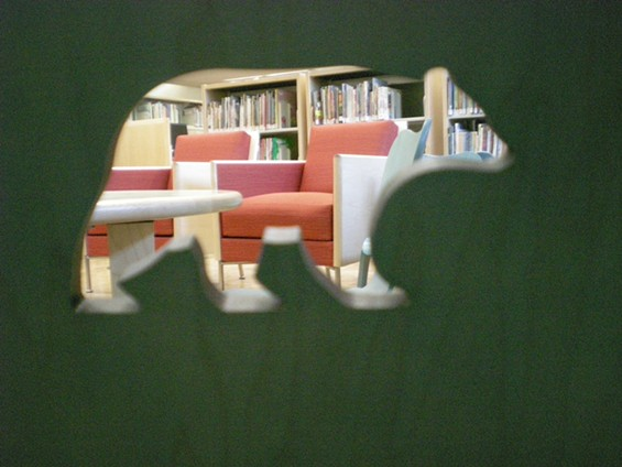 The library glimpsed through the bear cutout on one of its adorable little kiddie chairs - JOE ESKENAZI