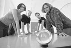 PAOLO  VESCIA - The Long Now Team: Catherine Bacon, Alexander - Rose, Kurt Bollacker, and Jim Mason, with an early - prototype of the Rosetta Disk.
