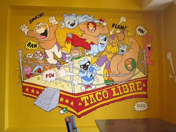 The lucha libre cartoon murals are by Sirron Norris. - LUIS CHONG